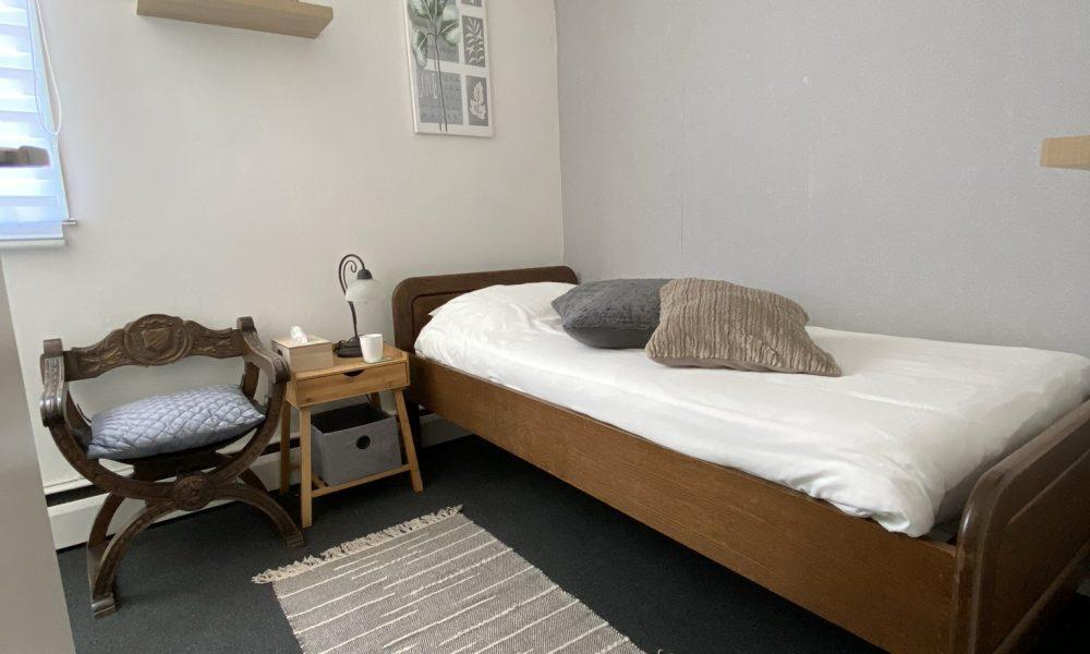 Kamer met gedeelde badkamer